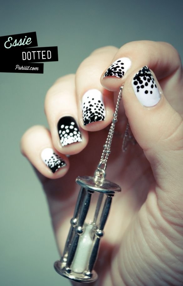 Black and white divergent polka dots nail art