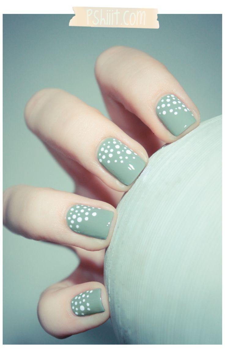 Chic white polka dots on monochrome nails