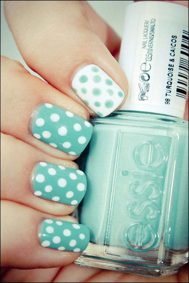Light blue and white polka dots nail art