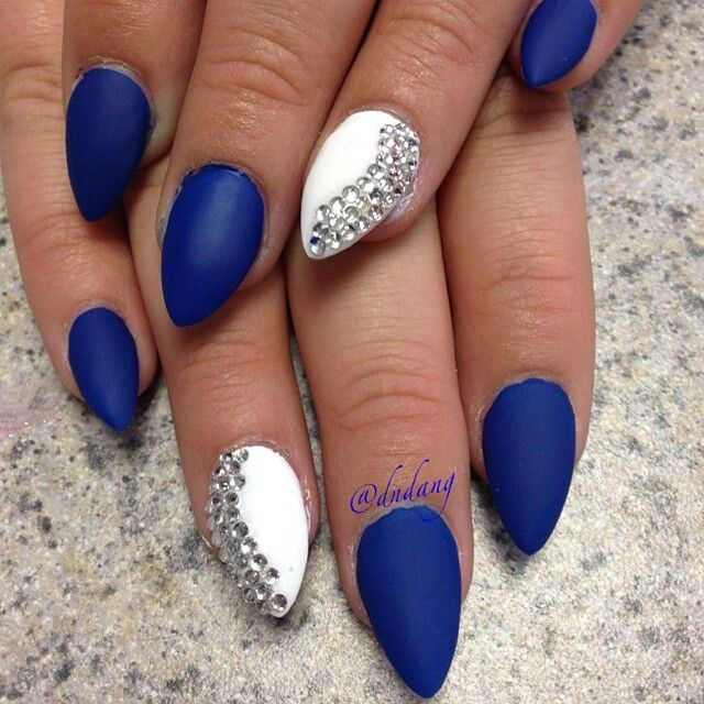 Matte blue and white stiletto nails with rhinestones