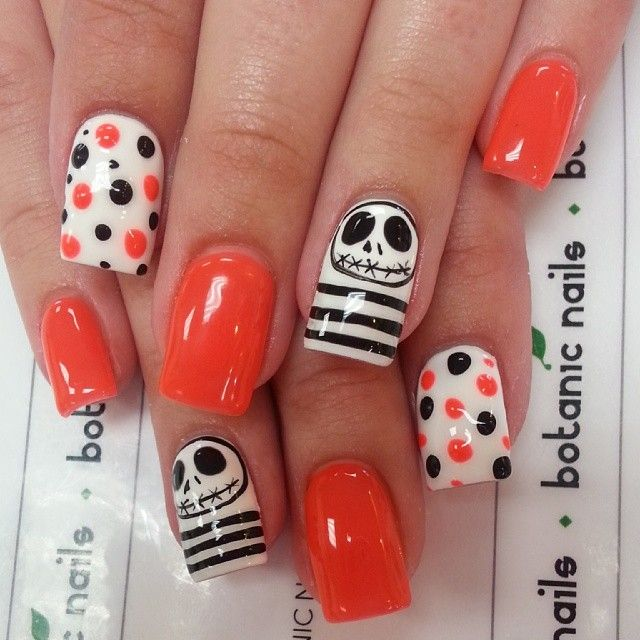 Halloween inspired pop nails with orange and polka dots