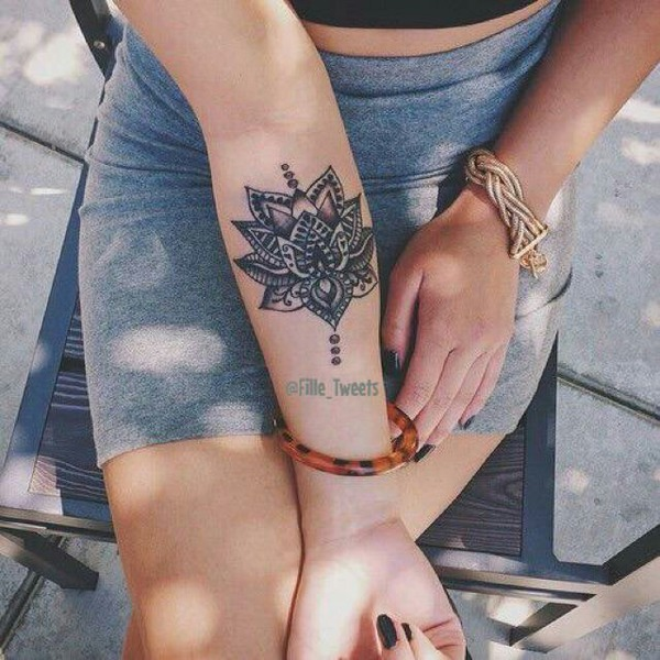 Mandala inspired lotus tattoo on arm