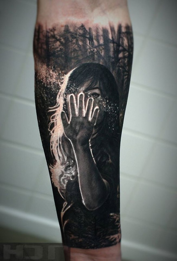 Realistic forearm tattoo