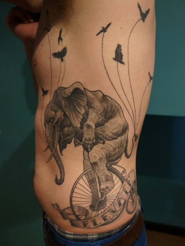 elephant biking tattoo