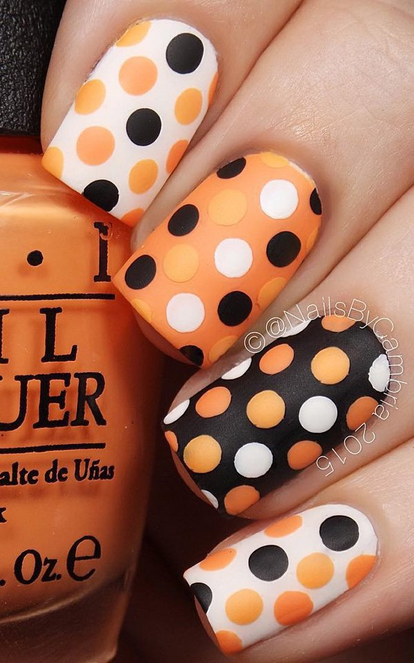 Black and orange polka dots nails