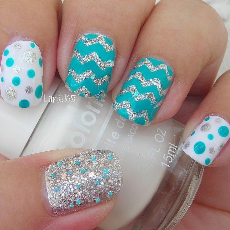 Blue themed polka dots glitter and Chevron nails
