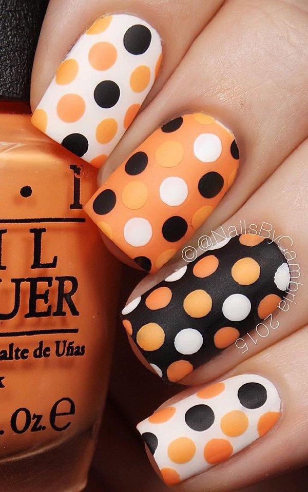 Black and orange polka dots nails